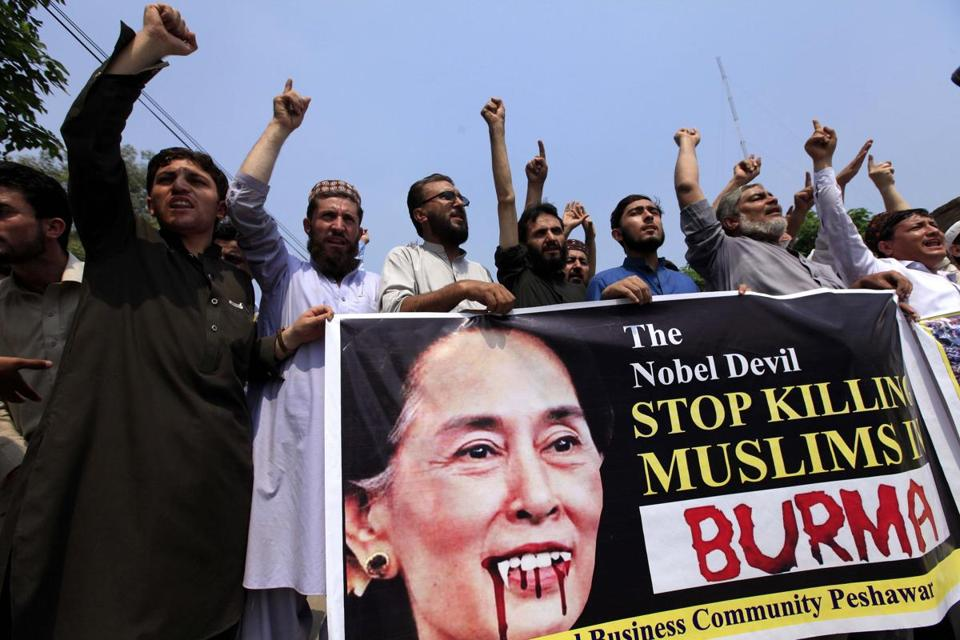 People in Peshawar, Pakistan, held up a picture of Aung San Suu Kyi while protesting violence in Myanmar.