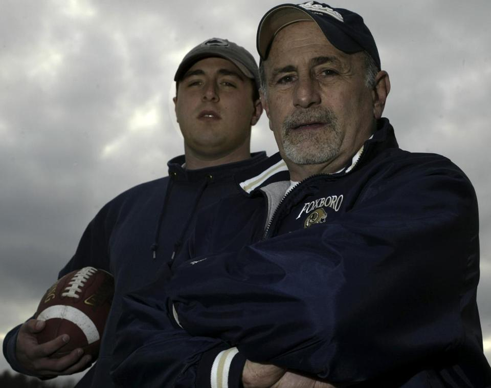 Foxoborough, Ma. 11/29/05 Holliston resident Jack Martinelli (cq) ,right,is the head coach of the Foxboro High football team. His son, Brian Martinelli (cq),left, a former star player at Holliston High, is a first-year assistant coach. Foxborough was 9-1 entering the MIAA Division 2 Super Bowl playoffs. (Bill Polo/Globe Staff)section:wewk;slug:04wefoxb;reporter Mike Reiss Library Tag 12042005 Globe South 1, 2 Library Tag 12042005 Globe West 1, 2, 3