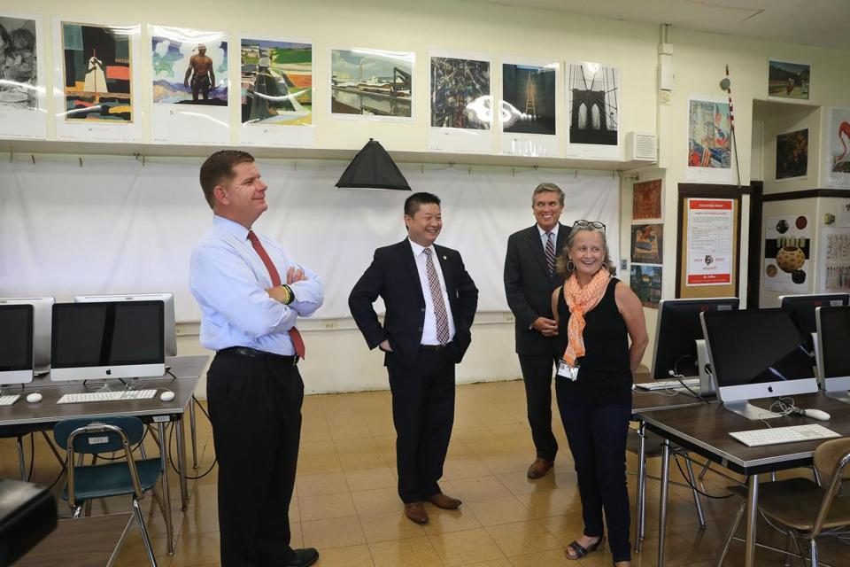 Boston Mayor Martin J. Walsh, from left, Superintendent Tommy Chang, and Boston School Committee Chairman Michael D. O'Neill visit the graphic arts studio of teacher Patricia Kelliher at Brighton High School on Thursday.