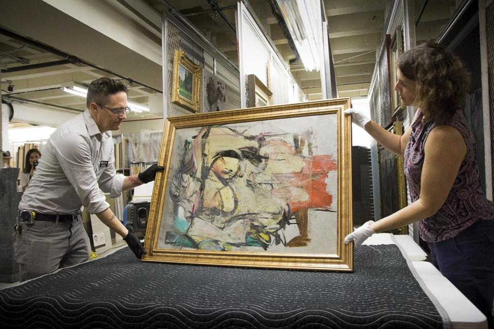 "Nathan Saxton and Kristen Schmidt readied Willem de Kooning's ""Woman-Ochre"" for examination in Phoenix."