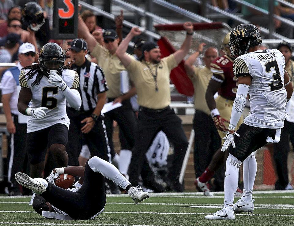 Wake Forest's bench erupts as defensive back Cameron Glenn intercepts a pass in the first quarter.