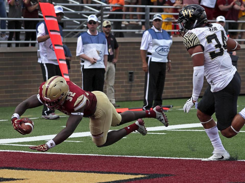 Jon Hilliman dives into the end zone in the second quarter for BC's only touchdown.