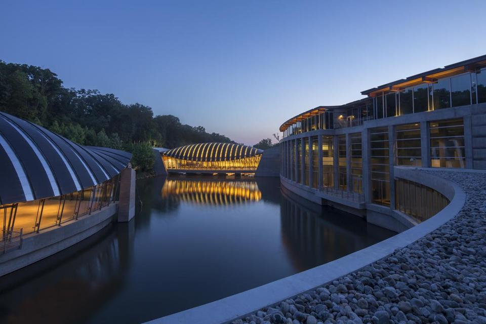 Crystal Bridges Museum with its arch-roofed pavilions that appear to float above the water