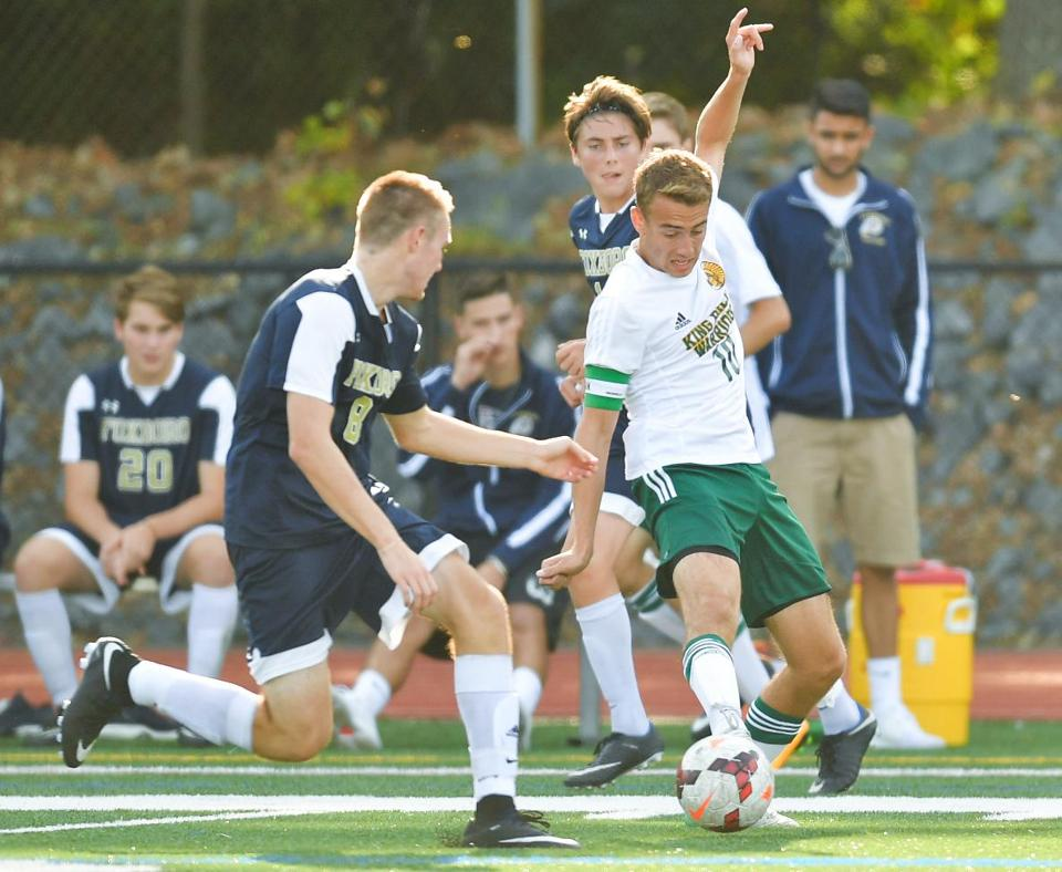 King Philip's Tyler Mann (10) gets control of the ball as Foxboro's Ryan Kelley (8) looks on during the first half of their high school soccer game in Wrentham, Monday, Sept. 11, 2017. Gretchen Ertl for The Boston Globe.