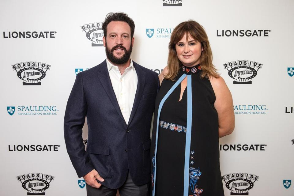 "09/12/2017 BOSTON, MA Writer John Pollono (cq) with his wife Jennifer Pollono (cq) on the red carpet before a screening of ""Stronger"" at Spaulding Rehabilitation Center in Boston. (Aram Boghosian for The Boston Globe)"