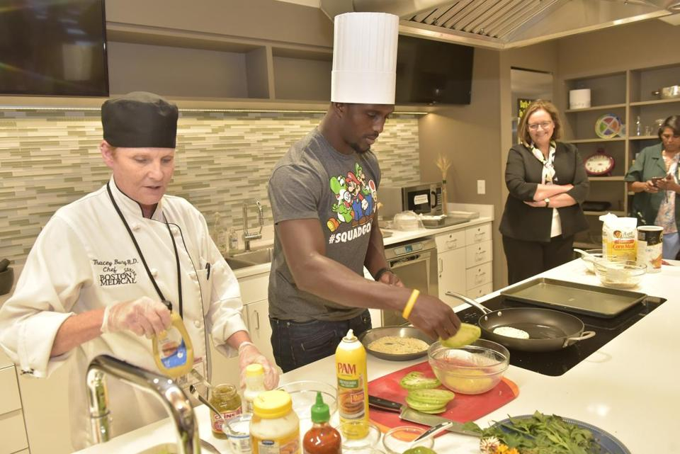 Devin McCourty (center) at work in Boston Medical Center's demonstration kitchen.
