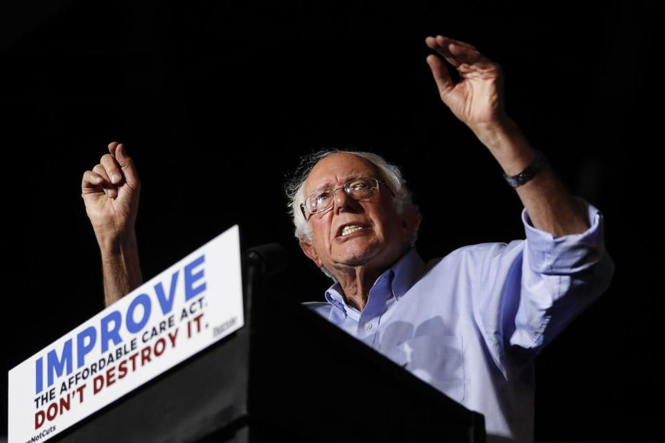"In this July 9, 2017 photo, Sen. Bernie Sanders, I-Vt., speaks during a ""Care Not Cuts"" rally in support of the Affordable Care Act in Covington, Ky. House Minority Leader Nancy Pelosi is declining to endorse Sen. Bernie Sanders' universal health care bill saying that while she has long supported the idea the bill captures, of everybody getting health coverage, ""Right now I'm protecting the Affordable Care Act."" (AP Photo/John Minchillo)"