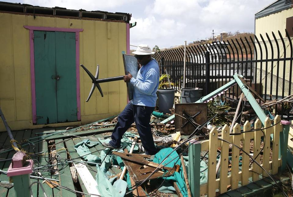 Cruz Bay, St. John -- 9/12/2017 - A man clears away a deck of debris left behind by Hurricane Irma in the Cruz Bay section of St. John. (Jessica Rinaldi/Globe Staff) Topic: Reporter: