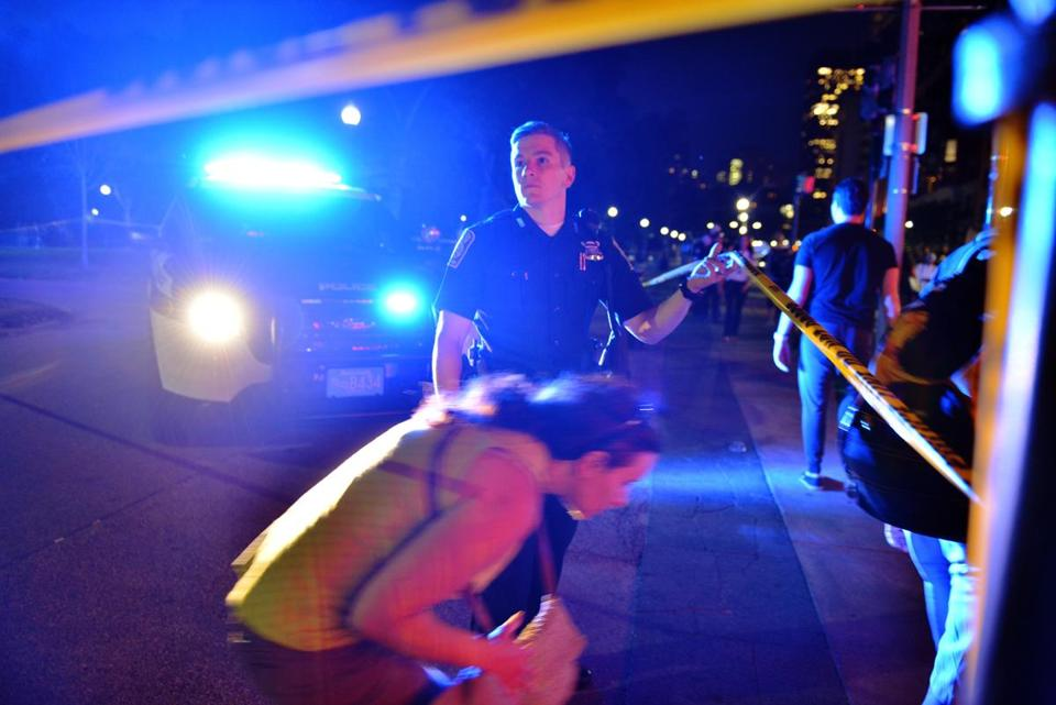 A police officer directed bystanders after the shooting on Boston Common on Tuesday night.