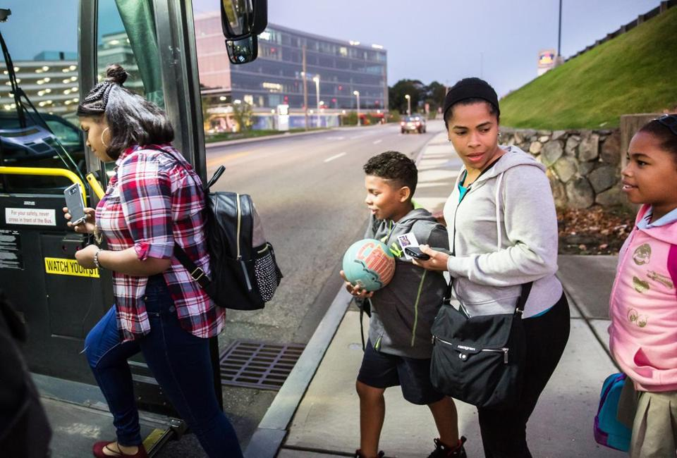 Ivelisse Florentino boarded a bus with her three children outside their temporary housing at the Home Suites Inn in Waltham. From left are emily Familia, 16, Daniel Santana, 9, and Daniela Santana, 10.