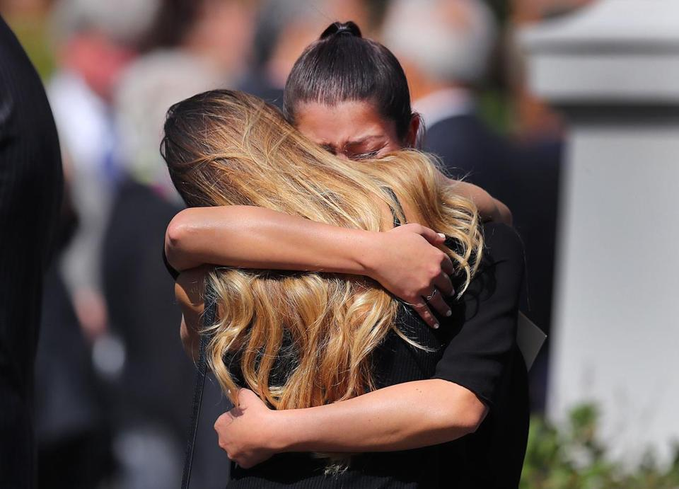 Two women hugged at the end of the service.