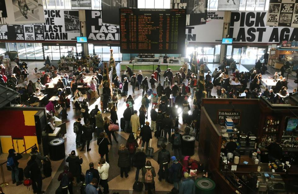Travelers filled the terminal at South Station.