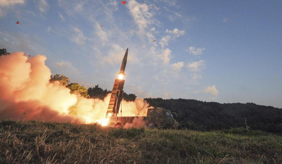 In an undated handout photo, a Hyunmoo-2 missile is fired by South Korea's military during an exercise on Sept. 4, 2017.