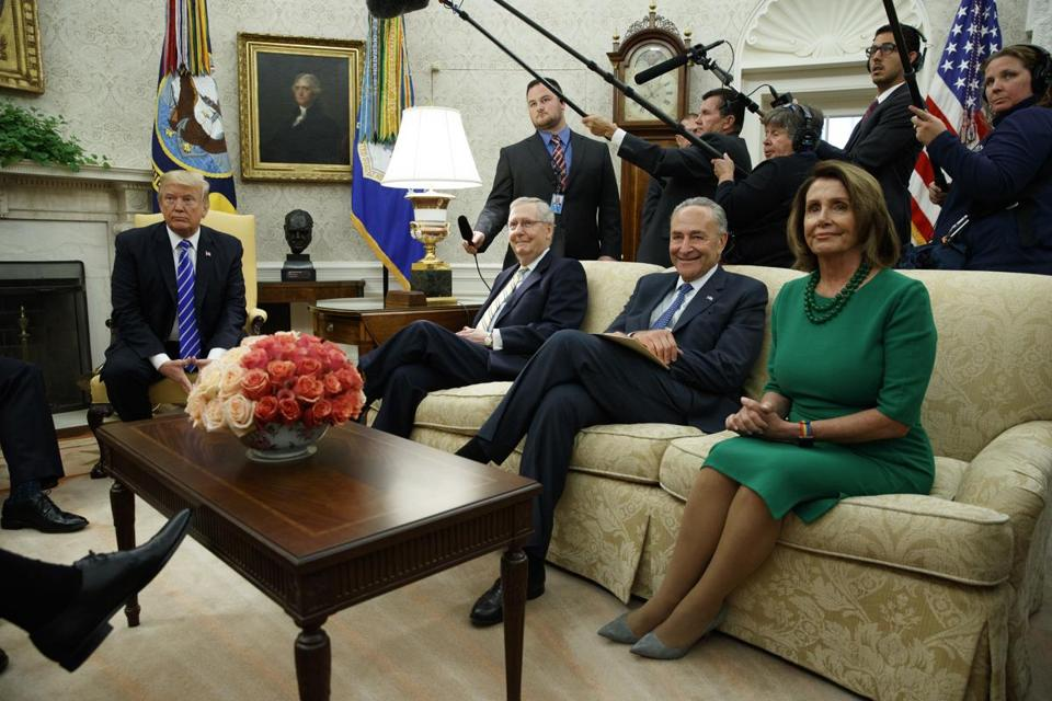 President Donald Trump meets with, from left, Senate Majority Leader Mitch McConnell, R-Ky., Senate Minority Leader Chuck Schumer, D-N.Y., and House Minority Leader Nancy Pelosi, D-Calif., and other congressional leaders in the Oval Office last week.