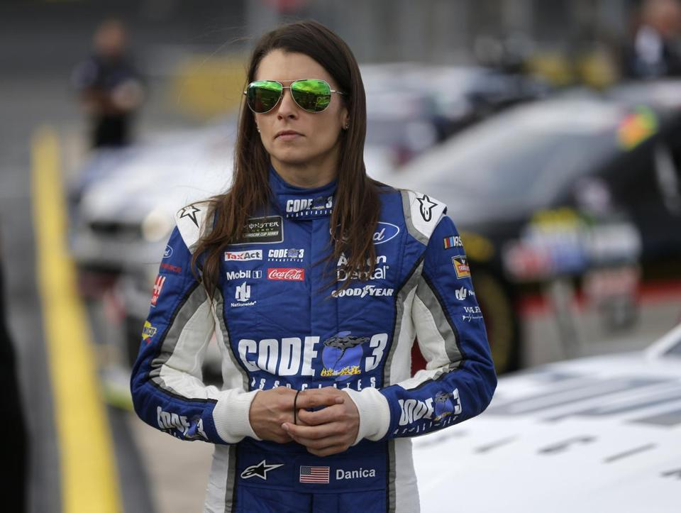 "FILE - In this Thursday, May 25, 2017 file photo, Danica Patrick stands by her car before qualifying for Sunday's NASCAR Cup series auto race at Charlotte Motor Speedway in Concord, N.C. Danica Patrick is done at Stewart-Haas Racing and her future in NASCAR is now up in the air amid a sponsorship shake-up. Patrick posted a statement on her Facebook page Tuesday, Sept. 12, 2017 saying her time with Stewart-Haas ""had come to an end"" due to a new sponsorship arrangement for the team next season. (AP Photo/Chuck Burton, File)"
