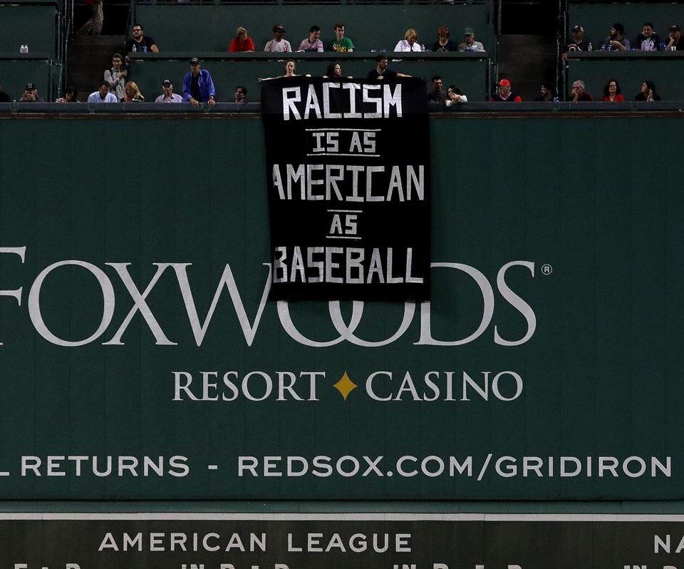This banner protesting racism was unfurled over the Green Monster during the Sept. 13 game at Fenway Park.
