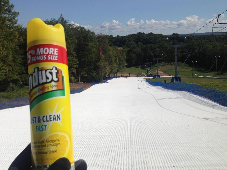 Furniture polish on the base of skis or a snowboard helps reduce friction on the synthetic surface.