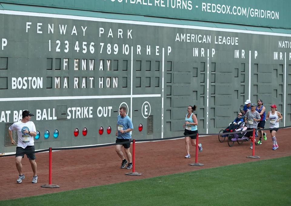 Runners began the race in front of the left field wall.
