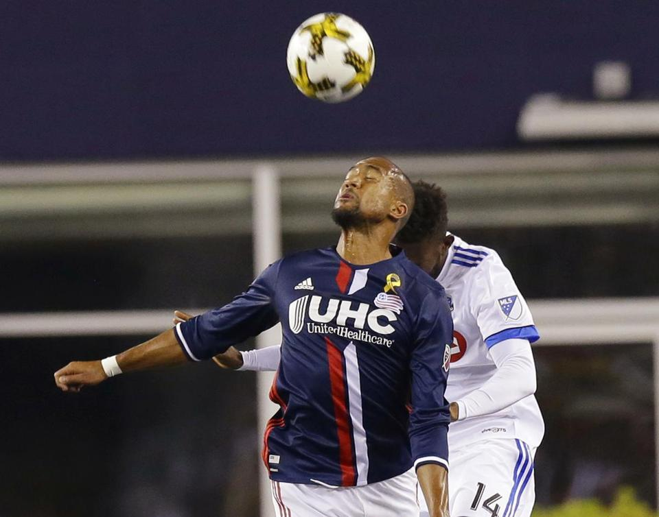 New England Revolution forward Teal Bunbury (10),heads the ball away from Montreal Impact midfielder Adrian Arregui (14) during the first half of their MLS soccer game, Saturday, Sept. 9, 2017, in Foxborough, Mass. The Revolution defeated the Impact 1-0. (AP Photo/Stephan Savoia)