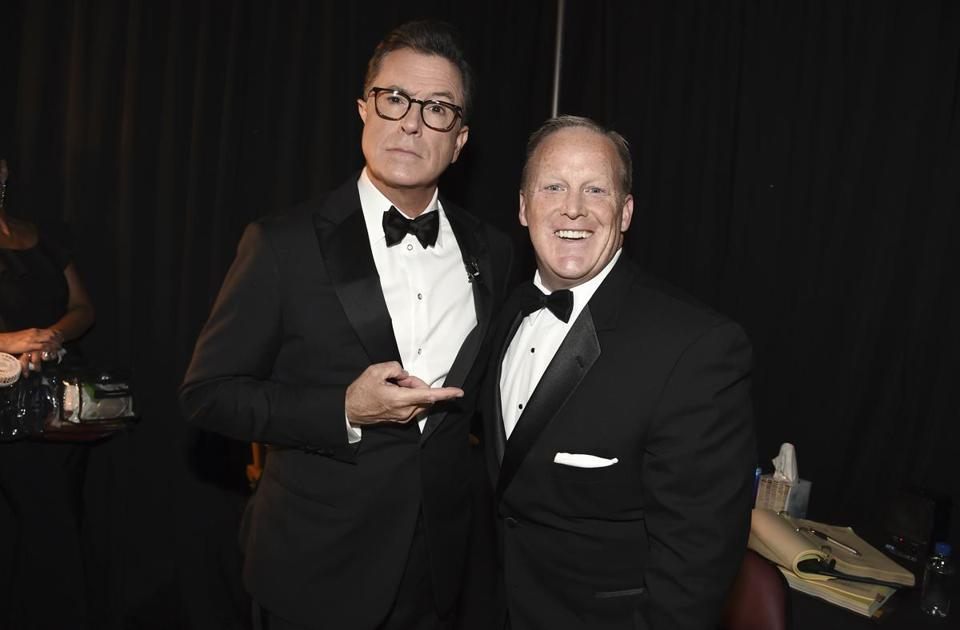 Stephen Colbert, left, and Sean Spicer pose backstage at the 69th Primetime Emmy Awards on Sunday, Sept. 17, 2017, at the Microsoft Theater in Los Angeles. (Photo by Dan Steinberg/Invision for the Television Academy/AP Images) 19crit