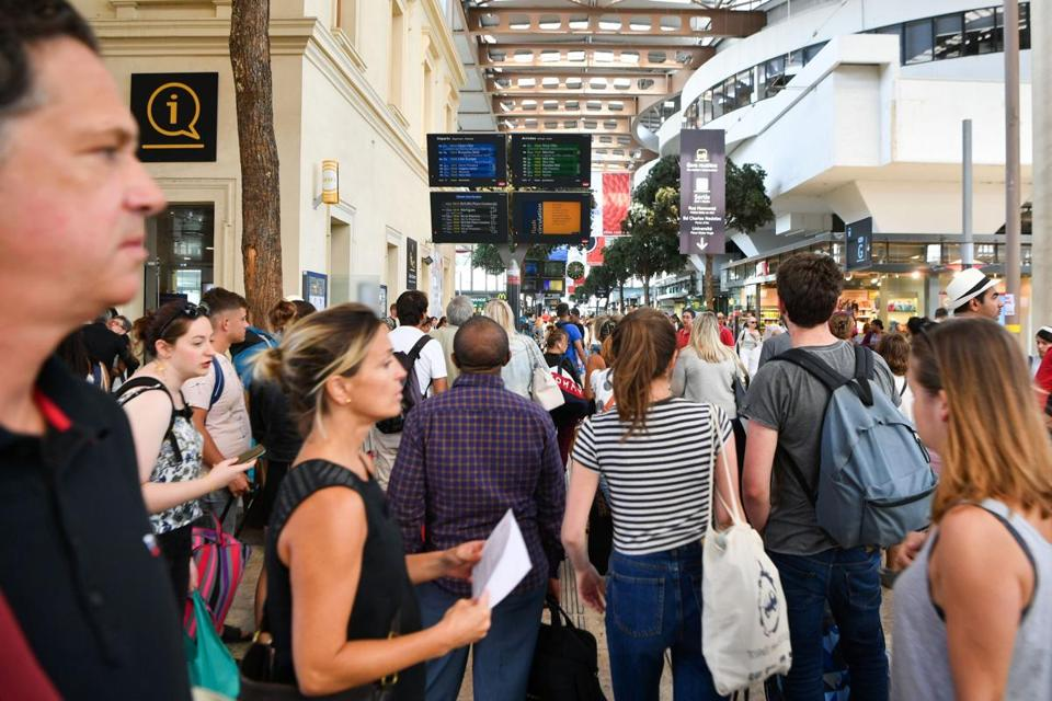Passengers looked at information monitors as they waited for their trains at The Saint-Charles Station in Marseille last month.
