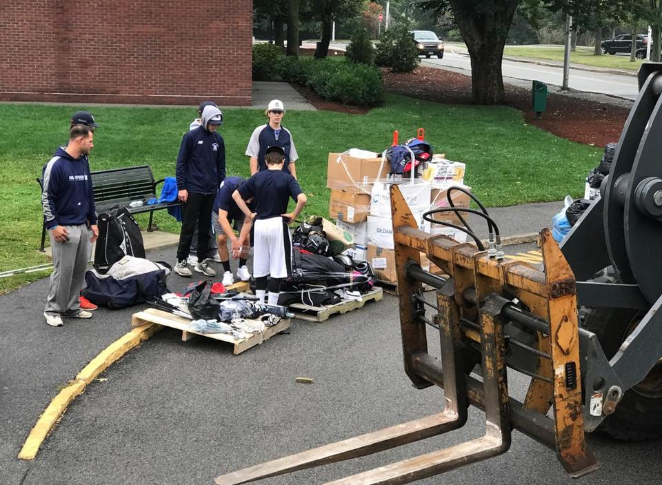 24nomedfordweb - Student athletes sort equipment to be loaded into the 18-wheeler. (Bob Maloney)