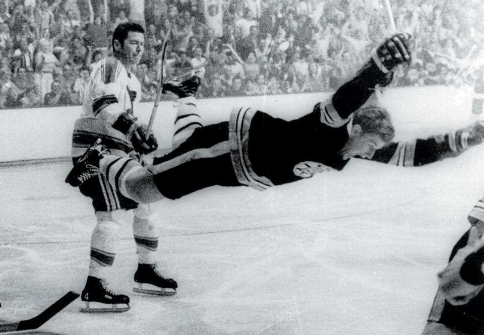 Noel Picard (left) launches Bobby Orr into history.