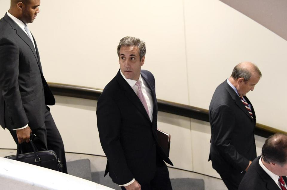 Michael Cohen, President Donald Trump's personal attorney (center) walked with his attorney Stephen M. Ryan (second from right) as they left Capitol Hill in Washington.