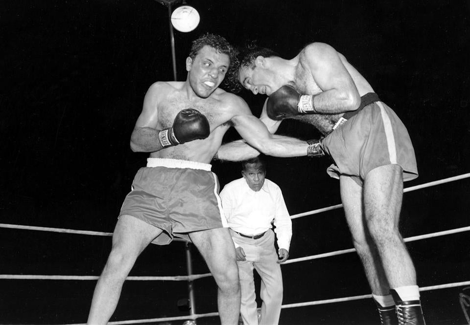 Jake LaMotta (left) won the middleweight title by beating Marcel Cerdan in 1949.
