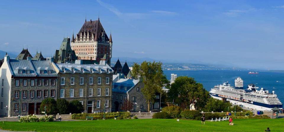 A view of the cruise port of Quebec City with the Chateau Frontenac rising in the distance at left.