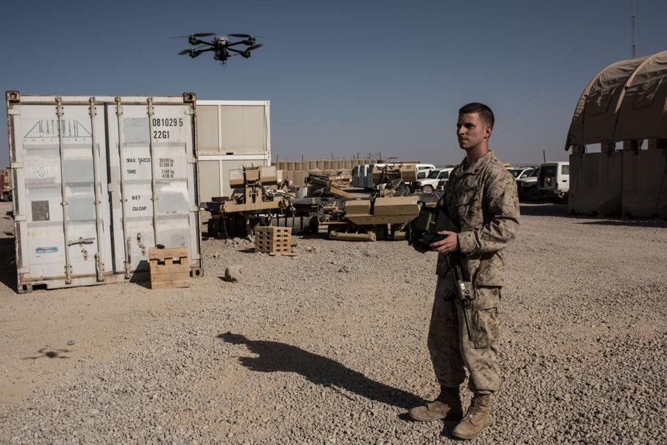CAMP SHORAB, AFGHANISTAN - SEPTEMBER 10: U.S. Marine Corporal Isaac Brown, from Virginia, operates a surveillance drone which provides base security on September 10, 2017 at Camp Shorab in Helmand Province, Afghanistan. About 300 marines are currently deployed in Helmand Province in a train, advise, and assist role supporting local Afghan security forces. Currently the United States has about 11,000 troops in the deployed in Afghanistan, with a reported 4,000 more expected to arrive in the coming weeks. Last month, President Donald Trump announced his plan for Afghanistan which called for an increase in troop numbers and a new conditions-based approach to the war, getting rid of a timetable for the withdrawal of American forces in the country. (Photo by Andrew Renneisen/Getty Images)