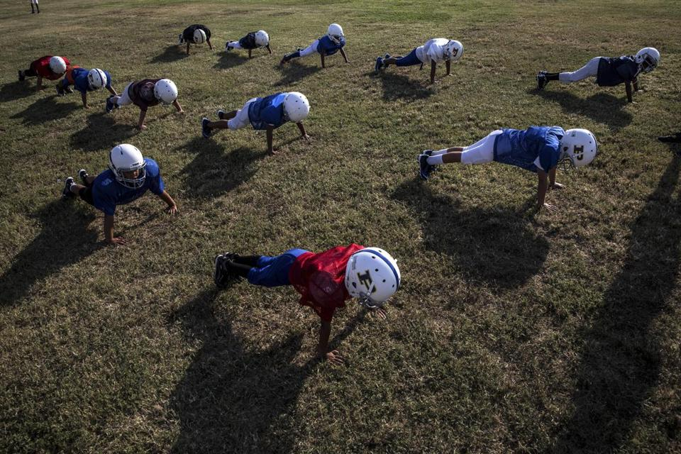 Eight- and nine-year-old Pop Warner football players practice in Pflugerville, Texas in 2015.