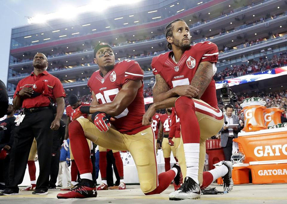 In 2016, San Francisco 49ers safety Eric Reid (left) and quarterback Colin Kaepernick (right) knelt during the national anthem.