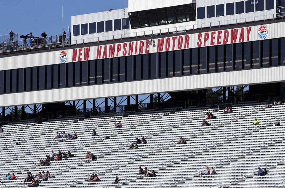 Race fans watch practice for the NASCAR Cup Series 300 auto race at New Hampshire Motor Speedway in Loudon, N.H., Saturday, Sept. 23, 2017. (AP Photo/Charles Krupa)