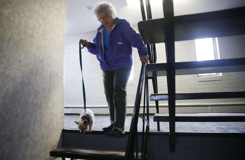 Doris Toohey, 85, walked down the stairs at her condo in Brighton with her dog, Bonnie.