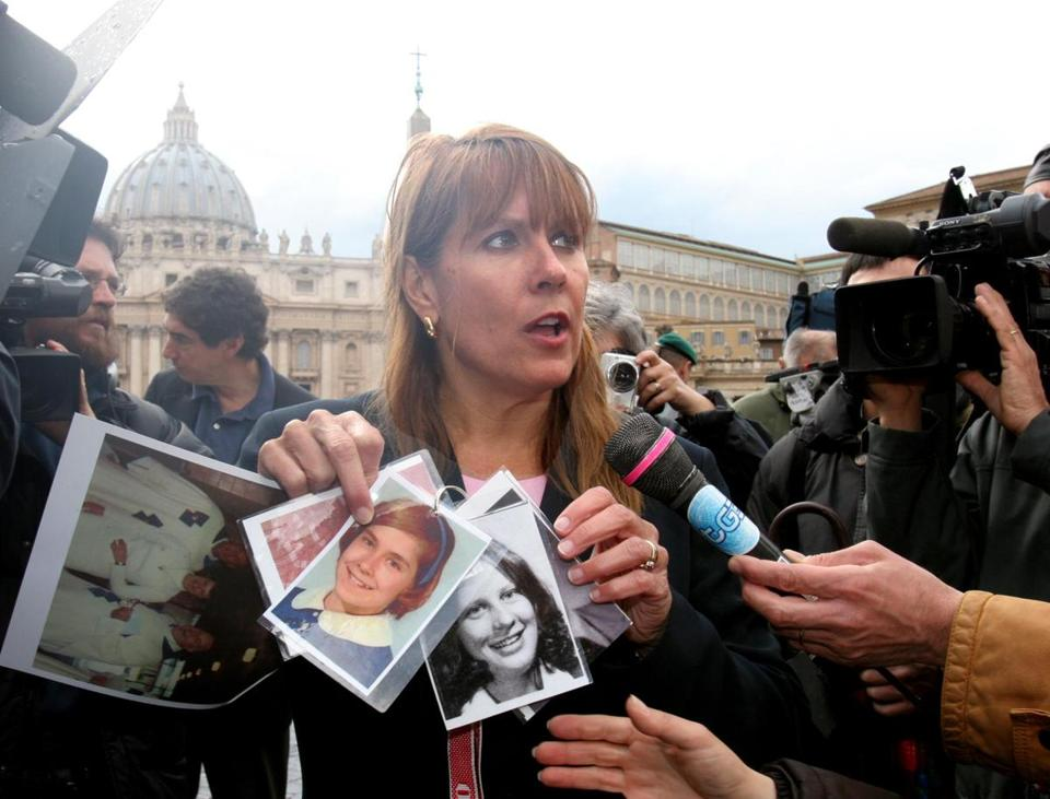 Ms. Blaine displayed a picture of herself at age 12 (center, left) while protesting outside St. Peter's Square in 2005.