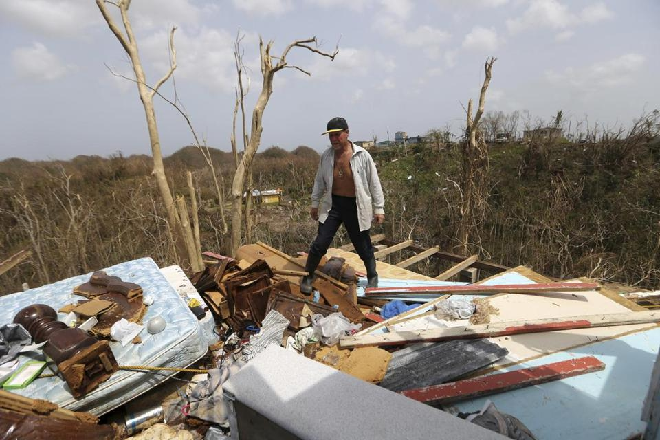 Jose Trinidad observed the ruins of his home in Montebello, Puerto Rico, on Tuesday.