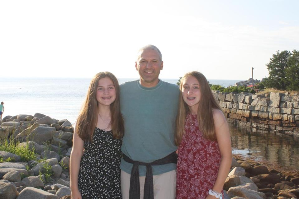 Eric Dahl, with his daughters Casey (left), 12, and Emma, 14.