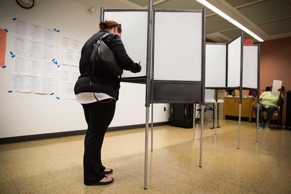 Local resident Elizabeth McNamara voted at the Lower Mills branch of the Boston Public Library in the preliminary election on Tuesday.