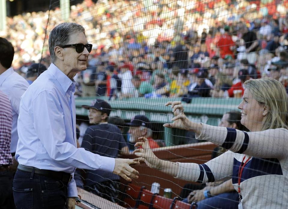 Boston Red Sox principal owner John Henry greeted fans before a baseball game at Fenway Park.