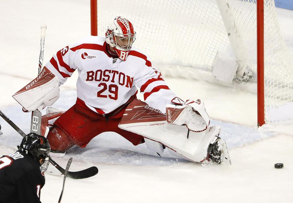 Boston University goaltender Jake Oettinger makes a save against Northeastern during the first period at Agganis Arena in Boston, Saturday, Nov. 5, 2016. (Winslow Townson for The Boston Globe)