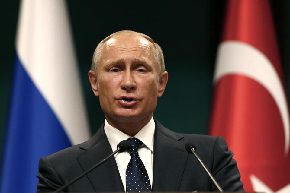 Russian President Vladimir Putin speaks during a news conference after the talks with Turkey's President Recep Tayyip Erdogan in Ankara, Turkey, Thursday, Sept. 28, 2017. Russian President Vladimir Putin is Ankara for talks with Erdogan on developments in Iraq and Syria, and Turkey's decision to purchase a Russian-made missile defense system. (AP Photo/Burhan Ozbilici)