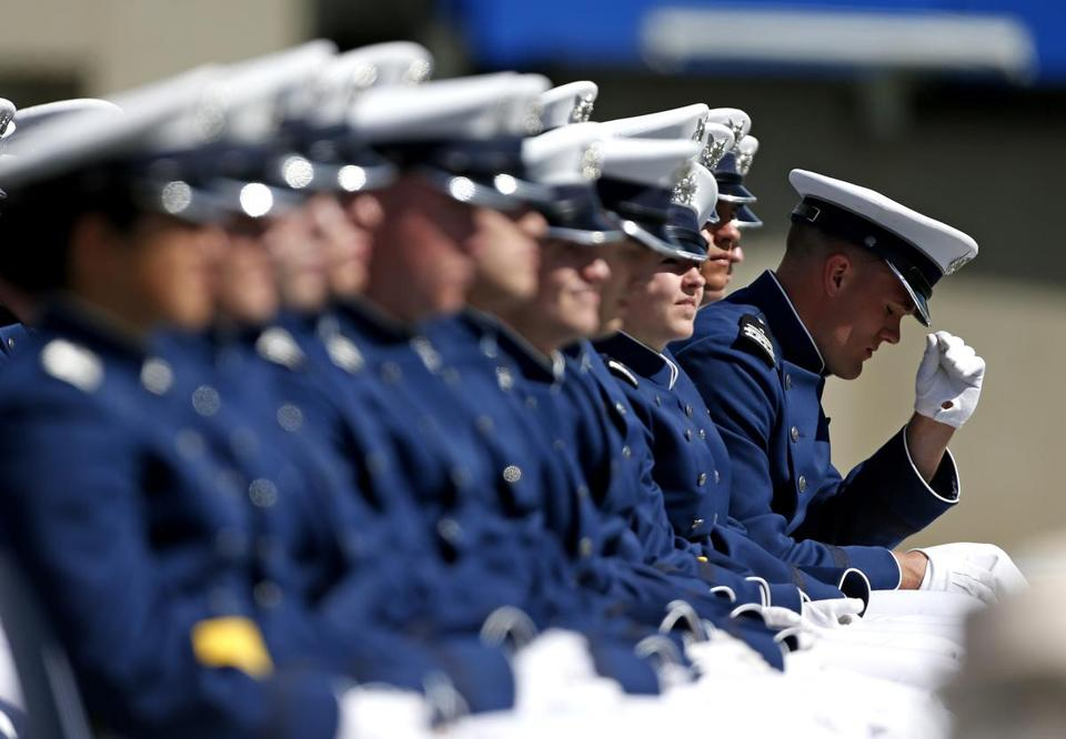 Racial slurs were found written on message boards outside dorm rooms of five black students at a preparatory school on the US Air Force Academy campus, officials said.