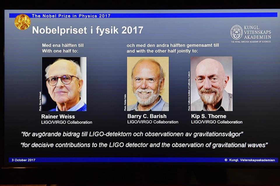 The 2017 Nobel Prize winners in Physics Rainer Weiss, Barry C. Barrish, and Kip S. Thorne (on screen left to right) were presented on a screen while being announced the Nobel Prize laureates in Stockholm, Sweden.