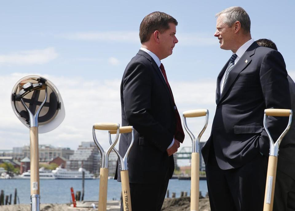 "East Boston, MA - 5/19/2016 - Mayor Marty Walsh (L) talks with Governor Charlie Baker at a groundbreaking ceremony for ""Boston East""a 200-unit housing development in East Boston, MA May 19, 2016. Jessica Rinaldi/Globe Staff Topic: 20corruptionpic Reporter:"