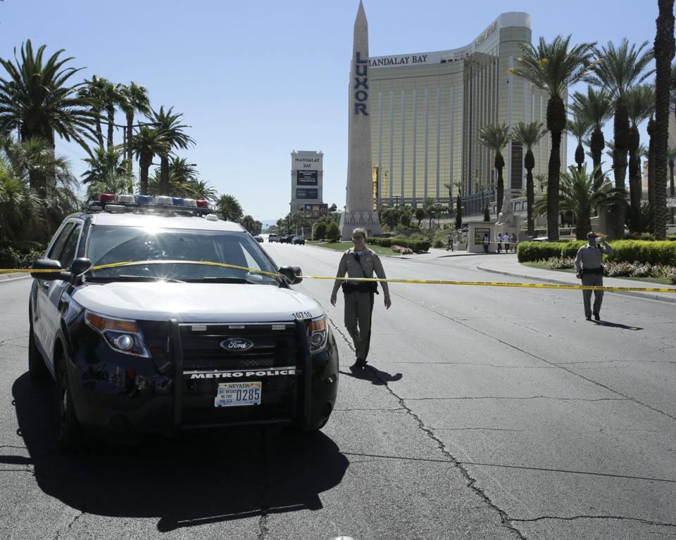 epa06240821 Police block the street near the scene of a mass shooting at the Route 91 Harvest festival on Las Vegas Boulevard in Las Vegas, Nevada, USA, 02 October 2017. Police reports indicate that a gunman, identified as Stephen Paddock, 64, firing from an upper floor of the Mandalay Bay hotel killed more than 50 people and injured more than 500 before he reportedly killed himself as police made their way to his hotel room. EPA/PAUL BUCK