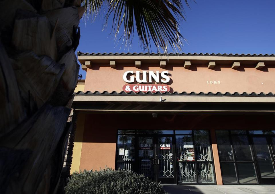 The Guns & Guitars store is shown in Mesquite, Nev., Monday, Oct. 2, 2017. The store's general manager Christopher Sullivan said in a statement Monday that Stephen Craig Paddock showed no signs of being unfit to buy guns. Paddock killed dozens and injured hundreds Sunday night when he opened fired at an outdoor country music festival in Las Vegas. (AP Photo/Chris Carlson)