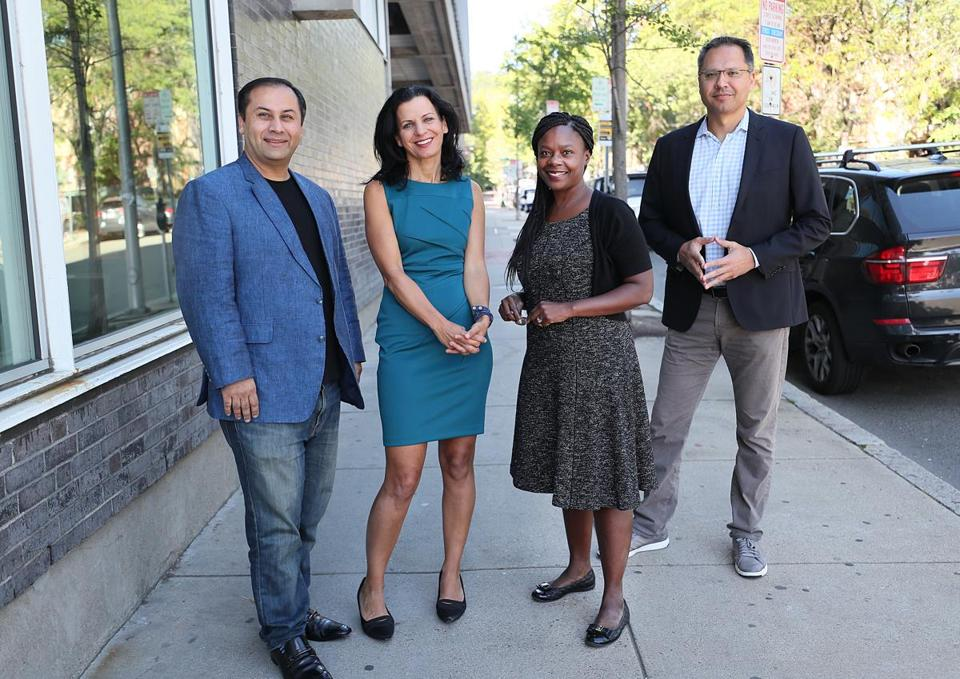 The executive team at Zemcar includes (left to right) Bilal Khan, founder; Juliette Kayyem, CEO; Donna Levin, a top adviser; and Shahid Azim, president.