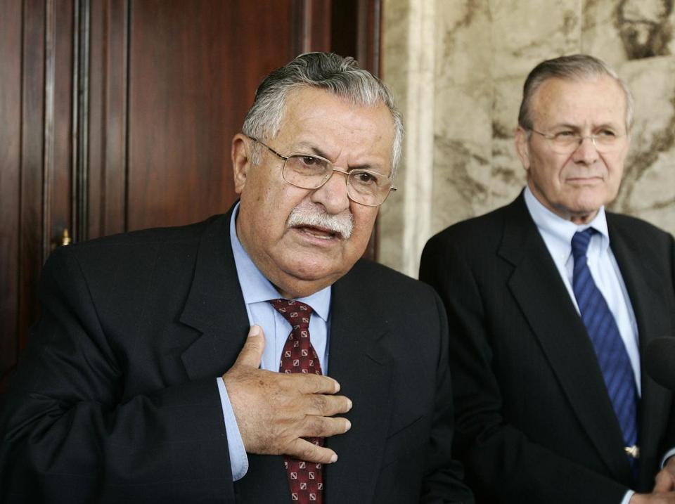 In this April 12, 2005 file photo, then Iraqi President Jalal Talibani, left, and then U.S. Secretary of Defense Donald Rumsfeld talk at a press availability in Baghdad, Iraq.
