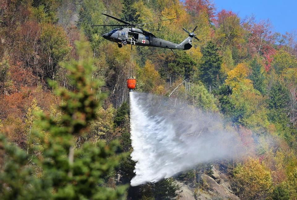 A black hawk helicopter dumped 600 gallons of water near the peak of the 600-foot high ridge.